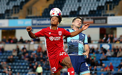 Bobby Reid of Bristol City heads the ball past Stephen McGinn of Wycombe Wanderers - Mandatory by-line: Robbie Stephenson/JMP - 09/08/2016 - FOOTBALL - Adams Park - High Wycombe, England - Wycombe Wanderers v Bristol City - EFL League Cup