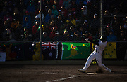 Liam O'Leary swings during the 2017 Men's World Softball Championship.