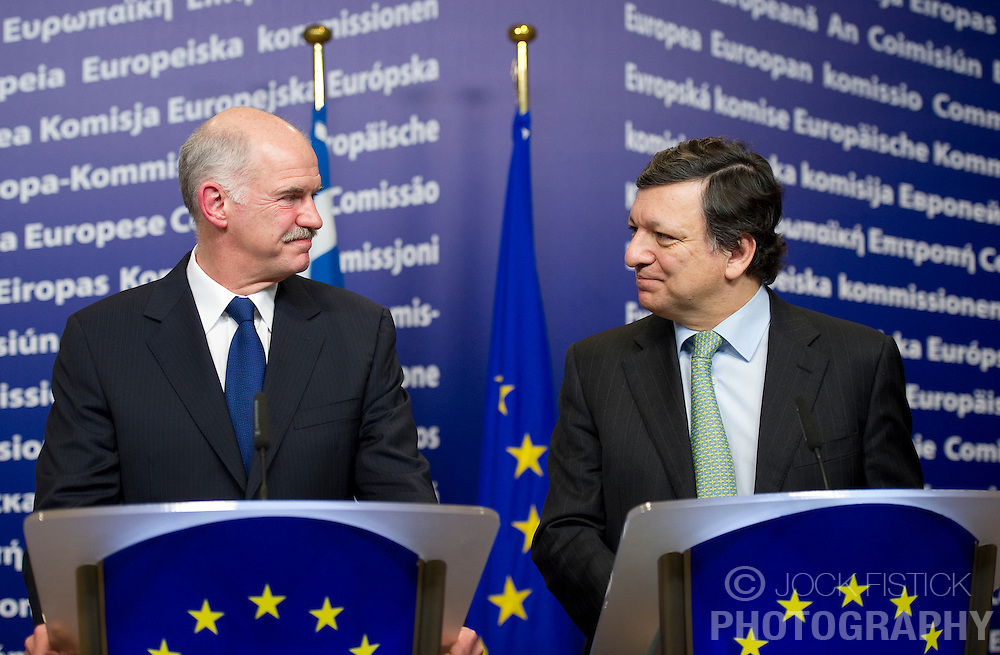 "George Papandreou, Greece's prime minister, left, and Jose Manuel Barroso, president of the European Commission, hold a press briefing following their meeting at the European Union Commission headquarters in Brussels, Belgium, on Wednesday, March 17, 2010. German Chancellor Angela Merkel said the European Union must avoid any ""overly hasty"" aid pledge to Greece. (Photo © Jock Fistick)"
