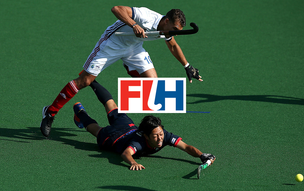 JOHANNESBURG, SOUTH AFRICA - JULY 13:  Genki Mitani of Japan and Viktor Lockwood of France battle for possession during day 3 of the FIH Hockey World League Semi Finals Pool A match between Japan and France at Wits University on July 13, 2017 in Johannesburg, South Africa.  (Photo by Jan Kruger/Getty Images for FIH)