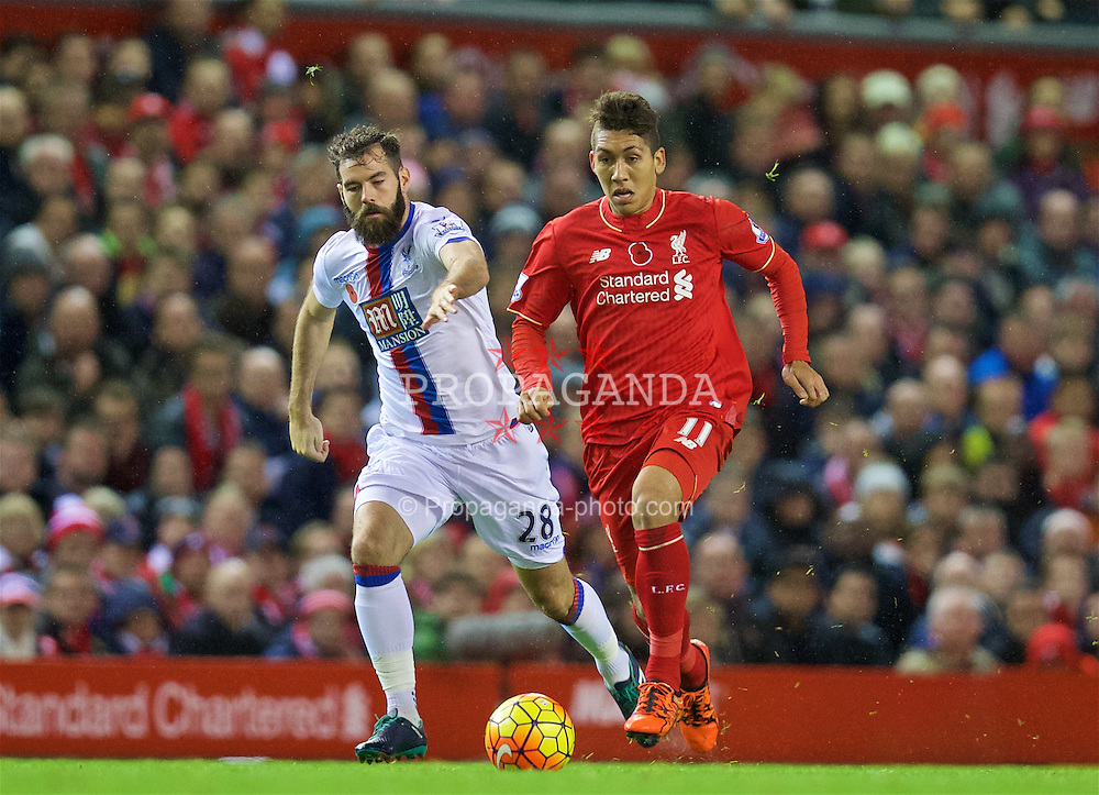 LIVERPOOL, ENGLAND - Sunday, November 8, 2015: Liverpool's Roberto Firmino in action against Crystal Palace's Joe Ledley during the Premier League match at Anfield. (Pic by David Rawcliffe/Propaganda)