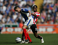Photo: Lee Earle.<br /> Portsmouth v Sunderland. The Barclays Premiership. 22/04/2006. Pompey's Andres D'Alessandro (L) battles with Justin Hoyte.