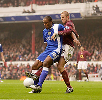 Photo: Daniel Hambury.<br />Arsenal v Cardiff City. The FA Cup. 07/01/2006.<br />Arsenal's Philippe Sanderos (R) and Cardiff's Cameron Jerome battle for the ball.
