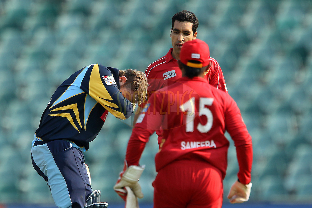 Umar Gul reacts as David Miller falls to the ground after being it in the face by his delivery during 1st Qualifying match of the Karbonn Smart CLT20 South Africa between Uva Next and Yorkshire held at The Wanderers Stadium in Johannesburg, South Africa on the 9th October 2012..Photo by Ron Gaunt/SPORTZPICS/CLT20