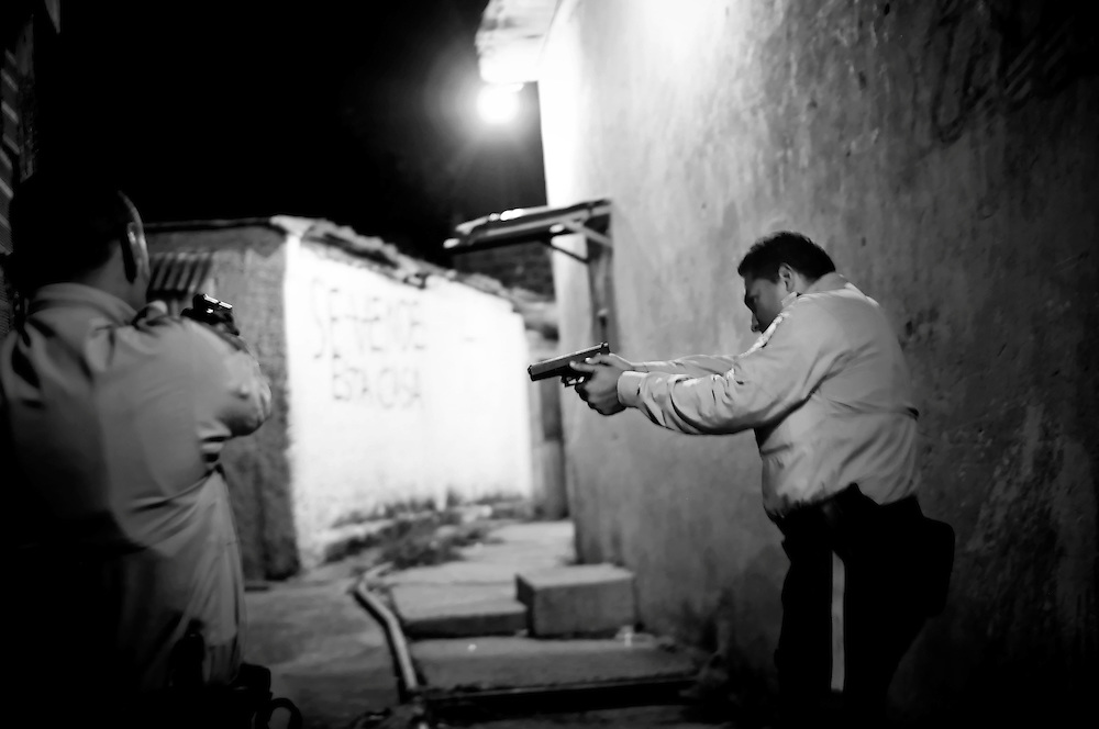 A special tactical division of the Sucre police force conducts a late night foot patrol in Petare. 91 percent of crimes go unsolved in Venezuela.