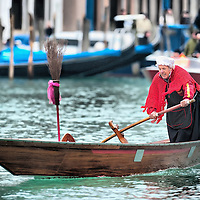 VENICE, ITALY - JANUARY 06: A  participant of the Befana Regata is seen rowing on the Canal Grande on January 6, 2011 in Venice, Italy.  In Italian folklore, Befana is an old woman who delivers gifts to children throughout Italy on Epiphany January 6 iin a similar way to Saint Nicholas or Santa Claus