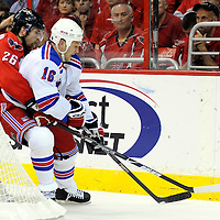 28 April 2009:   Washington Capitals defenseman Shaone Morrisonn (26) and New York Rangers left wing Sean Avery (16) vie for the puck in the 2nd period in the seventh game of the Eastern Conference NHL quarterfinal playoff game at the Verizon Center in Washington, D.C.  The Washington Capitals defeated the New York Rangers 2-1 in the Eastern Conference NHL quaterfinal playoff to advance to the second round of the playoffs.