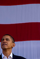 U.S. Senator Barack Obama (D-ILL) stands in front of a American flag as he and Wisconsin Governor  Jim Doyle campaign for a get out the vote rally a week before the elections Tuesday Oct. 31, 2006 Milwaukee. photo by Darren Hauck