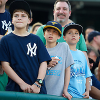 Boys wait field level in anticipation of an autograph from New York Yankees Third Baseman Alex Rodriguez before a minor league game for the AA Trenton Thunder in Trenton, NJ on August 3, 2013.  Rodriguez is facing a suspension by Major League Baseball for his alleged use of steroids with the Biogenesis clinic in Florida.