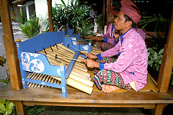 Gamelan Orchestra, Pacung, Bali, Indonesia, Asia, photo bali207, Photo Copyright:  Lee Foster, www.fostertravel.com, 510-549-2202, lee@fostertravel.com, music, musical, tune, instrument, entertainers, entertainment, costume, headdress, attraction, enjoyment, enlightment, travel, performers, players, horizontal