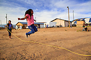 "12 JULY 2012 - FT DEFIANCE, AZ: A girl jumps rope in the children's play area at the 23rd annual Navajo Nation Camp Meeting in Ft. Defiance, north of Window Rock, AZ, on the Navajo reservation. Preachers from across the Navajo Nation, and the western US, come to Navajo Nation Camp Meeting to preach an evangelical form of Christianity. Evangelical Christians make up a growing part of the reservation - there are now more than a hundred camp meetings and tent revivals on the reservation every year. The camp meeting in Ft. Defiance draws nearly 200 people each night of its six day run. Many of the attendees convert to evangelical Christianity from traditional Navajo beliefs, Catholicism or Mormonism. ""Camp meetings"" are a form of Protestant Christian religious services originating in Britain and once common in rural parts of the United States. People would travel a great distance to a particular site to camp out, listen to itinerant preachers, and pray. This suited the rural life, before cars and highways were common, because rural areas often lacked traditional churches.     PHOTO BY JACK KURTZ"