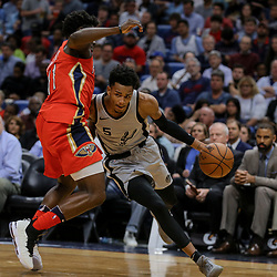 Apr 11, 2018; New Orleans, LA, USA; San Antonio Spurs guard Dejounte Murray (5) drives past New Orleans Pelicans guard Jrue Holiday (11) during the second half at the Smoothie King Center. The Pelicans defeated the Spurs 122-98. Mandatory Credit: Derick E. Hingle-USA TODAY Sports