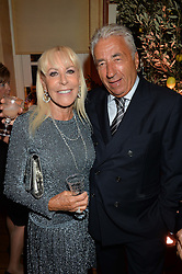 DAVID & SUZETTE MORRIS at a party to celebrate 35 years of Harry's Bar, 26 South Audley Street, London on 19th September 2014.