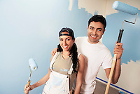 Couple with paint rollers portrait