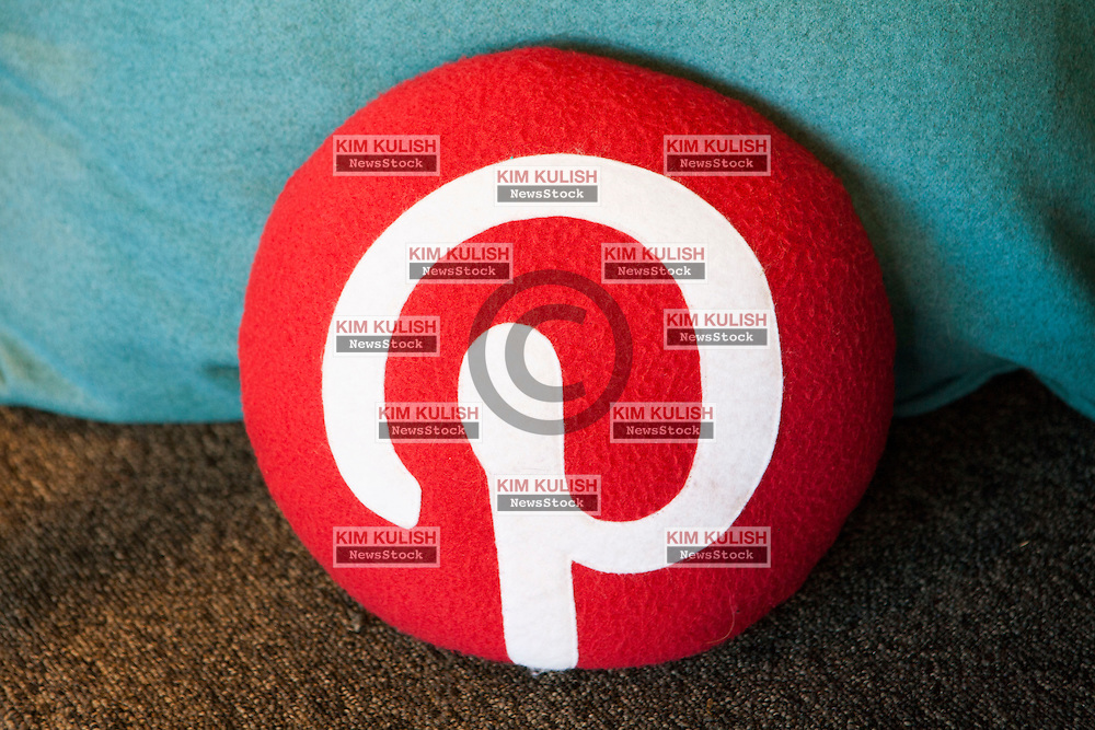 Scenes from Pinterest Headquarters in San Francisco, California.A pillow with the Pinterest logo.