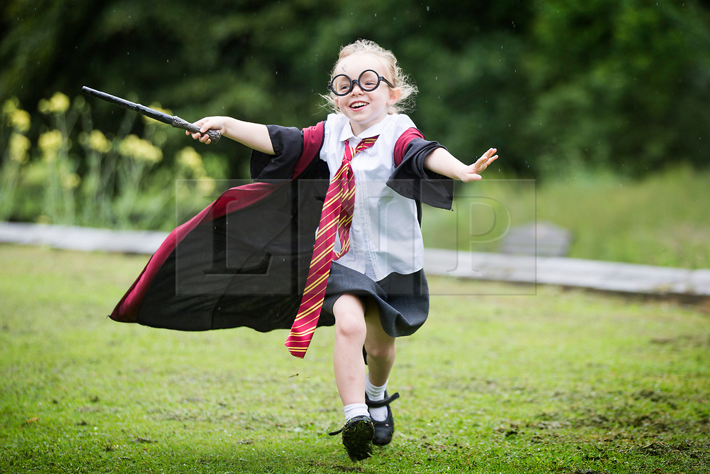 © Licensed to London News Pictures. 23/06/2017. Bolton UK. 4 year old Alice Burns takes part in a attempt to break the world record for the largest gathering of people dressed as Harry Potter that is taking place this morning at Smithhills Hall in Bolton. Bolton Museum & Library Services along with eleven local schools are coming together to try & break the record. Photo credit: Andrew McCaren/LNP