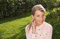 Little Girl Standing in back yard portrait
