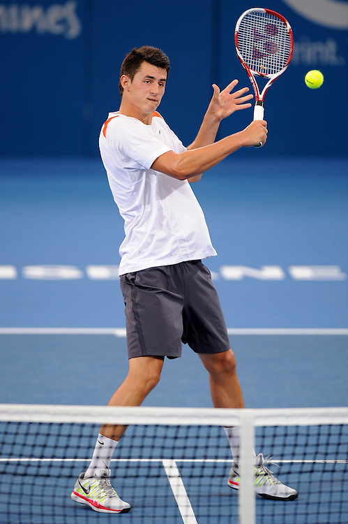 Brisbane, Australia, December 30: Bernard Tomic of Australia plays a backhand shot during a training session at Pat Rafter Arena ahead of the 2012 Brisbane International Tennis Tournament in Brisbane, Australia on Friday December 30th, 2011. (Photo: Matt Roberts/Photo News)