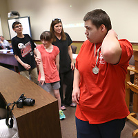 Adam Robison | BUY AT PHOTOS.DJOURNAL.COM<br /> Steven Morphis, from Shannon, walks with other Special Olympic athletes as they were recognized for their achievements in the local and state games by the Lee County School Board Tuesday night in Tupelo.