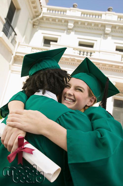 Graduates Hugging