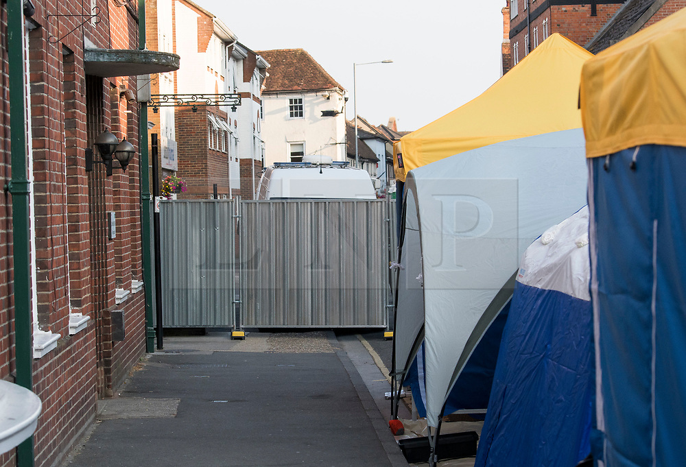 © Licensed to London News Pictures. 05/07/2018. Salisbury, UK. General view showing tents erected by a search team at the entrance to John Baker House in Salisbury, Wiltshire an area visited by two people who are in critical condition after being exposed to the Novichok nerve agent. Dawn Sturgess, 44, and Charlie Rowley, 45 hav been confirmed as having come in to contact with the deadly agent after samples were sent to the MoD's Porton Down laboratory. Former Russian spy Sergei Skripal and his daughter Yulia were poisoned with Novichok nerve agent in nearby Salisbury in March 2018 causing diplomatic tentions between Russia and the UK. Photo credit: Ben Cawthra/LNP