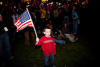 A young boy waves a American flag as supporters take to Chicago's Grant Park for the election night results for the presidential race between Sen. Barak Obama (D-IL) and Sen. John McCain (R-AZ) Tuesday Nov. 4, 2008 Chicago IL.