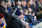 Young AFC Wimbledon fan watching the game during the EFL Sky Bet League 1 match between AFC Wimbledon and Blackpool at the Cherry Red Records Stadium, Kingston, England on 22 February 2020.