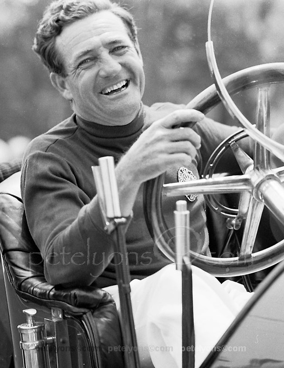 "Briggs Cunningham, ""Mr. C,"" at wheel of vintage car during 1952 sports car races in streets of Bridgehampton, NY."