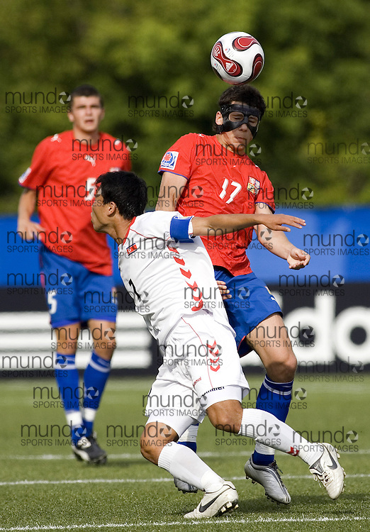 03 July 2007 (Ottawa--Canada) -- The Democratic People's Republic of Korea -- North Korea (PRK) -- ties the Czech Republic (CZE) 2-2 in the group stage of the FIFA U-20 World Cup of Football...Kum Il KIM and Marek SUCHY..Photo credit Sean Burges/Mundo Sport Images.