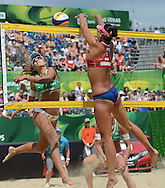 STARE JABLONKI POLAND - July 6:  Chen Xue of China and Barbara Seixas De Freitas of Brazil in action during Day 6 of the FIVB Beach Volleyball World Championships on July 6, 2013 in Stare Jablonki Poland.  (Photo by Piotr Hawalej)