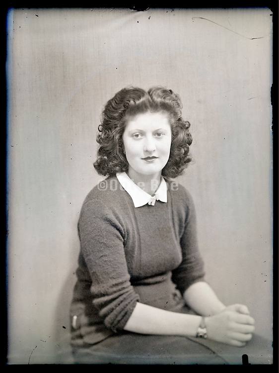 vintage studio portrait of a woman looking at the camera, circa 1930s