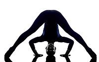woman exercising Prasarita Padottanasana Wide Legged Forward Bend pose yoga silhouette shadow white background