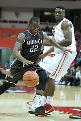 03 November 2013:  Jordan Wilson heads for the paint defended by John Jones during an mens exhibition basketball game between the Quincy Hawks and the Illinois State Redbirds in Redbird Arena, Normal IL
