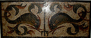 Dolphins with leaf-like fins on either side of a trident. Roman Mosaic from England circa 1st to 4th century AD