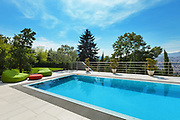 beautiful house, swimming pool nobody inside, summer day