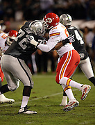 Kansas City Chiefs outside linebacker Tamba Hali (91) works his way around a block by Oakland Raiders tackle Donald Penn (72) during the NFL week 12 regular season football game against the Oakland Raiders on Thursday, Nov. 20, 2014 in Oakland, Calif. The Raiders won their first game of the season 24-20. ©Paul Anthony Spinelli