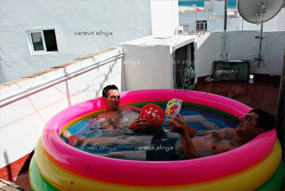 Florin,30 and Marian,31 share the same rented house with 4 rooms and terrace. Sometimes they find things in the street which spaniards don't need anymore, like this plastic pool.