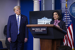 United States President Donald J. Trump, left, listens as Seema Verma, administrator of the Centers for Medicare and Medicaid Services, delivers remarks on the Coronavirus pandemic during a news conference in the James S. Brady Press Briefing room at the White House in Washington D.C., U.S., on Sunday April 19, 2020. Speaker of the United States House of Representatives Nancy Pelosi (Democrat of California) stated that lawmakers are close to a deal with United States Secretary of the Treasury Steven T. Mnuchin regarding a second round of small business loans for businesses impacted by Coronavirus. Credit: Stefani Reynolds / CNP