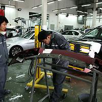 BEIJING, APRIL-22, 2010:  engineers in the repairstore of the BMW dealership .