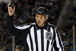 March 12, 2011; San Jose, CA, USA;  NHL linesman Pierre Racicot (65) during the first period at HP Pavilion. New York defeated San Jose 3-2 in shootouts. Mandatory Credit: Jason O. Watson / US PRESSWIRE