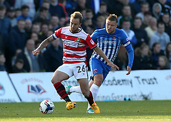 Tyler Walker of Doncaster Rovers takes on Nicky Featherstone of Hartlepool United - Mandatory by-line: Robbie Stephenson/JMP - 06/05/2017 - FOOTBALL - The Northern Gas and Power Stadium (Victoria Park) - Hartlepool, England - Hartlepool United v Doncaster Rovers - Sky Bet League Two