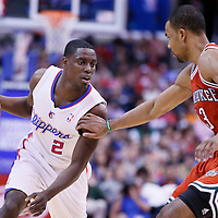 24 March 2014: Los Angeles Clippers guard Darren Collison (2) drives past Milwaukee Bucks guard Ramon Sessions (13) during the Los Angeles Clippers 106-98 victory over the Milwaukee Bucks at the Staples Center, Los Angeles, California, USA.