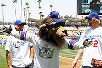 19 July 2009:  NHL LA Kings player Matt Green goofs off with Jared Stoll and mascot Bailey before the MLB Los Angeles Dodgers 4-3 win over the Houston Astros on a warm summer day in LA at Chavez Ravine during a National League Professional Baseball game.