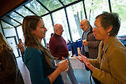 Rabbi Melissa Weintraub speaks with Val Vetter, coordinator of the Peace Studies Program, during the coffee social in the Forum South Lounge on Wednesday.