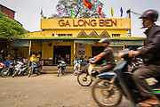 02 APRIL 2012 - HANOI, VIETNAM: Commuters ride past the Long Bien Train Station in Hanoi, the capital of Vietnam.    PHOTO BY JACK KURTZ