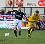 Dundee's Kevin McDonald goes past Morton's Peter Weatherson during the IRN BRU Scottish League First Division match at Dens Park
