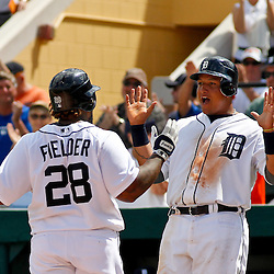 March 14, 2012; Lakeland, FL, USA; Detroit Tigers first baseman Prince Fielder (28) celebrates with teammate third baseman Miguel Cabrera (24) following a two run homerun against the New York Mets during the bottom of the fourth inning of a spring training game at Joker Marchant Stadium. Mandatory Credit: Derick E. Hingle-US PRESSWIRE