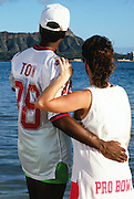 The American Football Conference New York Jets wide receiver Al Toon (88) looks with his wife at Diamond Head volcano on Waikiki Beach during the week before the 1989 NFL Pro Bowl football game against the National Football Conference on Jan. 24, 1989 in Honolulu. The NFC won the game 34-3. (©Paul Anthony Spinelli)