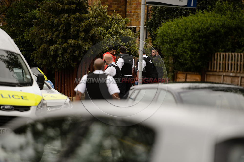 LONDON, ENGLAND, MAY 11, 2016: Metropolitain police officers, including armed response units, were called to a stabbing incident off Sipson Road in West Drayton, near Heathrow airport, in the early afternoon of Wednesday, May 11; at least three arrests were made, with individuals being detained at the scene. (Copyright: Martin McNeil)