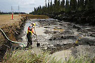 Opening road in the boreal forest for new mining operations. July 2008. © Etienne de Malglaive.
